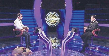 Kim Milyoner Olmak İster Görme Engelli Yarışmacı ve Köpeği Tabs